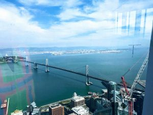 Bay bridge facing view from The Salesforce Tower and view from 61st Ohana Floor in Yerba Buena neighborhood of San Francisco by Matt Fuller Jackson Fuller real estate