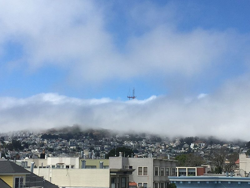 A View of The Fog on Twin Peaks Taken from The Mission Neighborhood